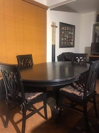 Round brown wooden table with four chairs dining set Chula Vista, 91910
