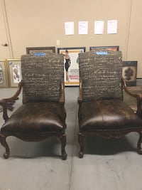 two brown wooden framed black leather padded armchairs Oklahoma City, 73170