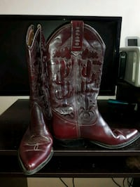 pair of brown leather cowboy boots Toronto, M1L 1L3