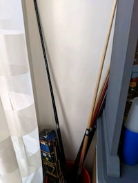 brown and black cue stick 34 km