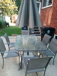 rectangular glass top table with four chairs patio set Riverdale Park, 20737