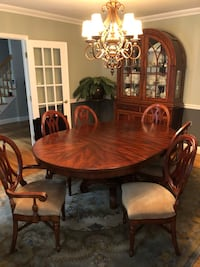 oval brown wooden dining table with chairs set North Salem, 10560