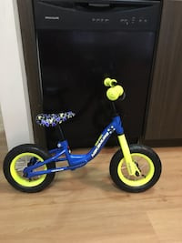 toddler's blue and yellow bicycle
