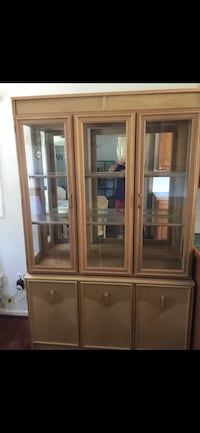 brown wooden framed glass display cabinet Gainesville, 20155