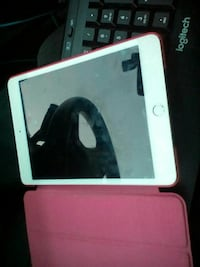 white iPad with pink case