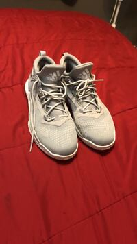 pair of grey-and-white Adidas sneakers