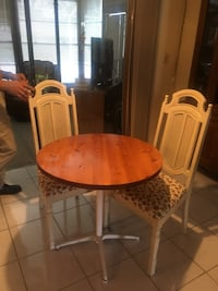 round brown wooden pedestal table with chairs Wesley Chapel, 33543