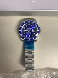 Luxury silver and blue watch not for free