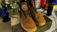 pair of brown Timberland work boots 11 mi