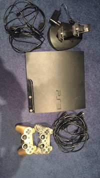 black Sony PS3 slim console with 2 controllers and 14 games
