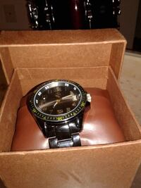 round black analog watch with link bracelet in box