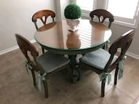round brown wooden table with four chairs dining set Toronto, M6M