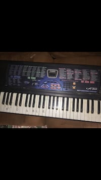 Casio black and white electronic keyboard