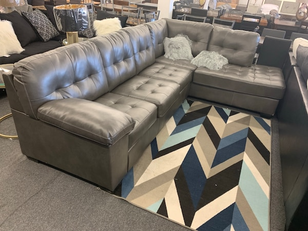 gray leather sectional sofa with throw pillows