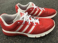 pair of red adidas running shoes 3736 km