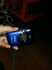 blue Samsung point-and-shoot camera