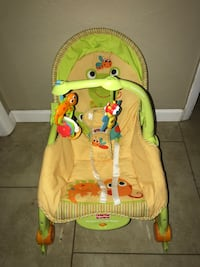 baby's brown and green Fisher-Price deluxe bouncer