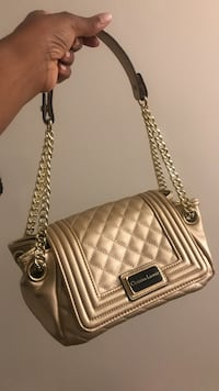 Gold Christian lacroix purse/hand bag. Very very pretty. Up for grabs. 24 mi