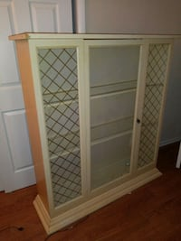 Wooden framed glass panel cabinet New Port Richey, 34653