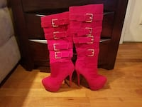 pair of red knee-high boots