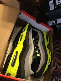 pair of black-and-green Nike sneakers Kissimmee, 34758