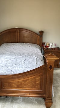 Brown wooden bed frame, 2 night stands and king box spring . 23 km