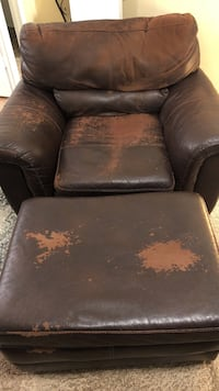 Leather chair and ottoman. $35 or best offer. worn but still comfortable. moving across state and everything must go!!