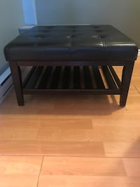 Black wooden framed black leather padded ottoman Halifax
