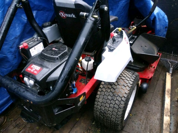 white and black ride on mower