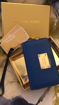 Blue michael kors leather wristlet with box. fits smart phones, mp3 player
