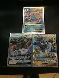 three assorted Pokemon trading cards null