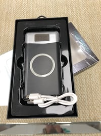 Wireless charger power bank. White or Black colour.New. Pick up in Concord . Vaughan, L4K