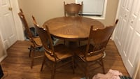 round brown wooden table with four chairs dining set Elwood, 46036