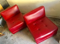 Two red leather sofa chairs