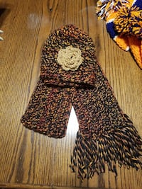 black, yellow and red knitted hat and scarf