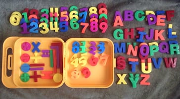 Magnetic letters and numbers in travel storage box