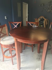 round brown wooden table with four chairs dining set Aldie, 20105
