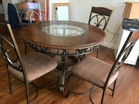 round brown wooden table with four chairs dining set Norwood, 02062