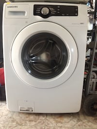 White Samsung front-load clothes washer and dryer set