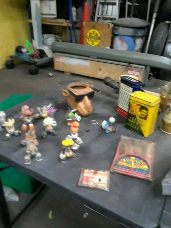 assorted plastic toys with boxes