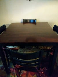 Pub style dining table with 4 chairs