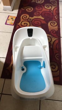 Baby's white and blue plastic bather Ocala, 34472