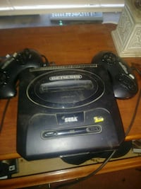 black Sega game console with controller Newport, 99156
