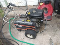 red and black Craftsman pressure washer