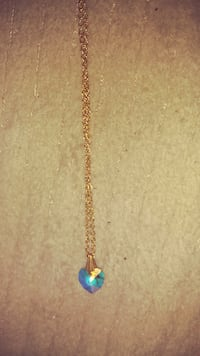 gold-colored and blue pendant necklace North Aurora