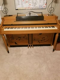 brown and black upright piano Fayetteville, 72704