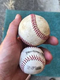 white and red baseball with signature Kent, 98030