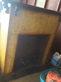 brown wooden fireplace heater frame