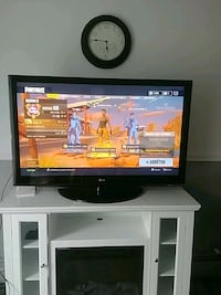 black flat screen TV with white wooden TV stand Montréal, H1K 3N8