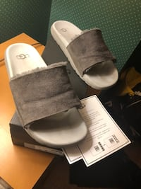 pair of gray leather slide sandals Calgary, T2R